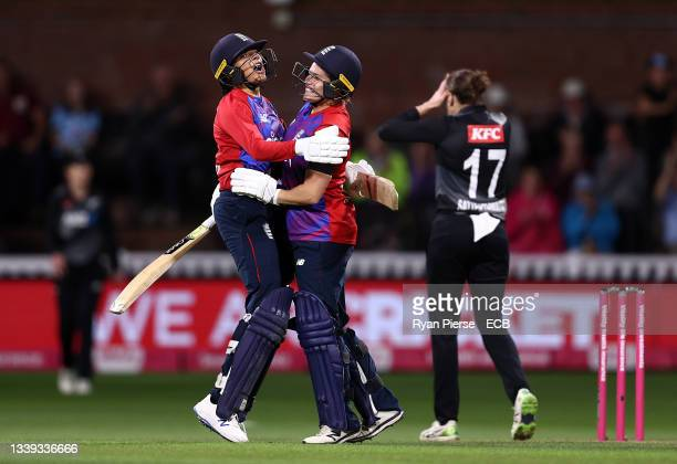 Sophia Dunkley and Katherine Brunt of England celebrate after hitting the winning runs during the 3rd Womens International T20 between England and...