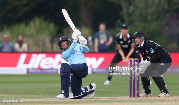 Sophia Dunkley of England bats as Katey Martin, Wicketkeeper of New Zealand looks on during the 5th One Day International match between England and...