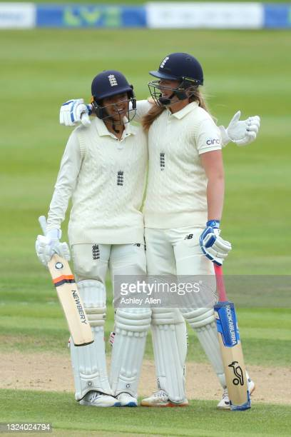 Sophia Dunkley of England is congratulated on her first half century in Test Cricket by teammate Sophie Ecclestone on Day Two of the LV= Insurance...