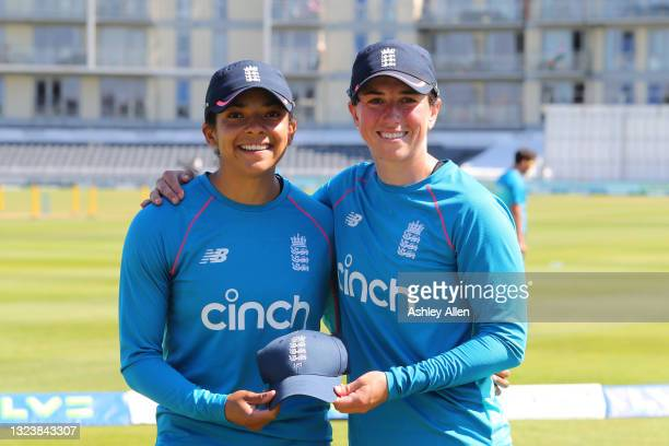 Sophia Dunkley of England receives her Test cap from teammate Georgia Elwiss on Day One of the LV= Insurance Test Match between England Women and...
