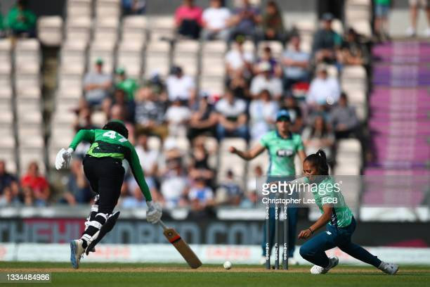 Sophia Dunkley of Southern Brave narrowly avoids getting runout by Shabnim Ismail of Oval Invincibles during The Hundred match between Southern Brave...