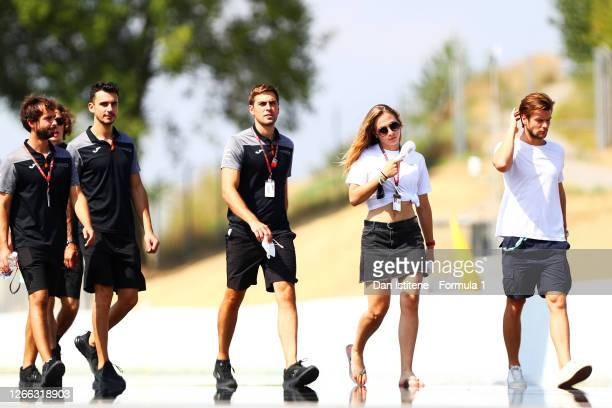 Sophia Floersch of Germany and Campos Racing walks the track with members of her team during previews ahead of the F1 Grand Prix of Spain at Circuit...