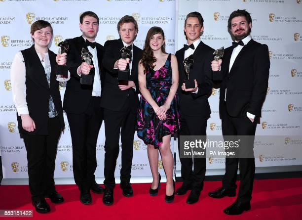 Sophia George presents Team DOS with the BAFTA Ones To Watch award for Size Does Matter at the British Academy Games Awards at Tobacco Dock London