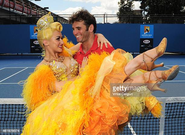 Sophia Katos from Strictly Ballroom the musical shows Malek Jaziri of Tunisia some dancing moves during the 2015 Australian Open at Melbourne Park on...