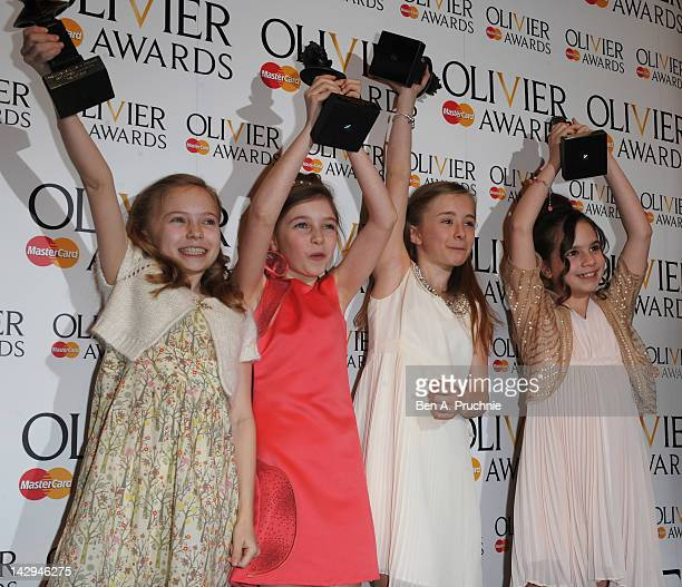 Sophia Kiely Eleanor Worthington Cox Kerry Ingram and Cleo Demetriou winners of Best Actress in a Musical for Matilda the Musical poses in the press...