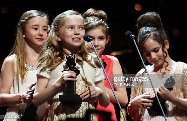 Sophia Kiely Kerry Ingram Eleanor Worthington Cox and Cleo Demetriou accept the award for Best Actress in a Musical for Matilda The Musical onstage...