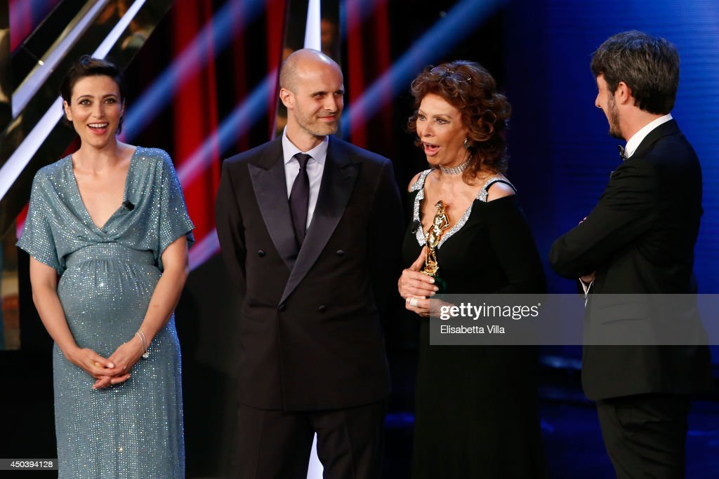 Sophia Loren and Edoardo Ponti receive a special award for 'Human Voice' as they attend the David Di Donatello Awards Ceremony at the Dear Studios on June 10, 2014 in Rome, Italy.