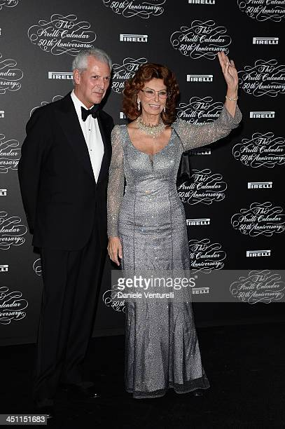 Sophia Loren and Marco Tronchetti Provera attend the Pirelli Calendar 50th Anniversary Red Carpet on November 21 2013 in Milan Italy