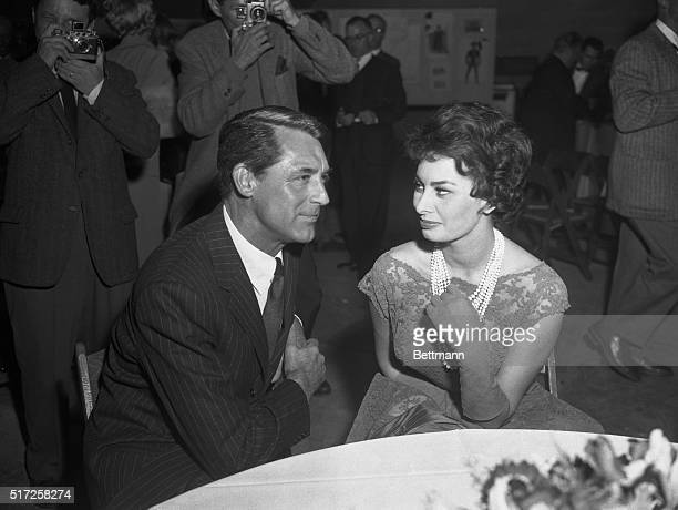 Sophia Loren is shown with actor Cary Grant at a cocktail party given by producer Stanley Kramer at a Hollywood studio tonight The affair was given...