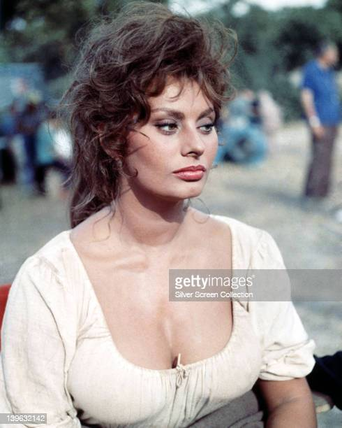 Sophia Loren Italian actress wearing a white blouse with a scoop neckline in peasant costume on a film set circa 1955