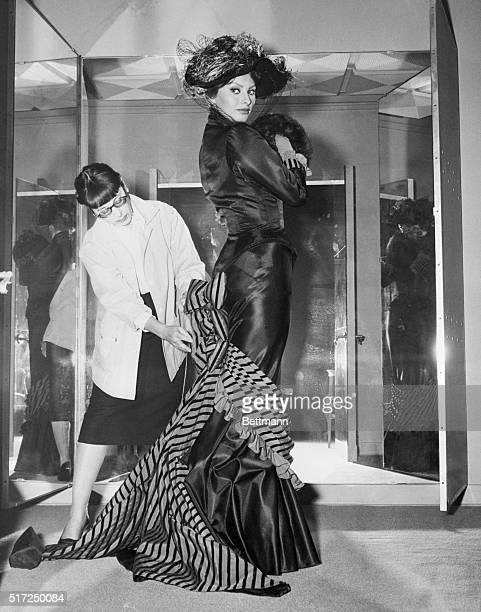 Sophia Loren poses in Designer Edith Head's mirrored fitting room wearing one of the many spectacular costumes created for her in her next Paramount...
