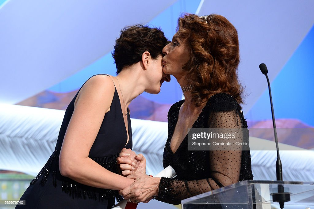 Sophia Loren presents on stage The Grand Prix award to director Alice Rohrwacher for her film 'The Wonders' at the Closing Ceremony during 67th Cannes Film Festival
