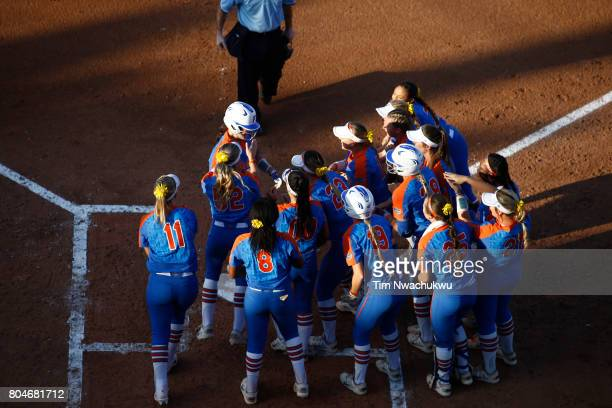 Sophia Reynoso of the University of Florida meets her teammates at home plate as they square off against the University of Oklahoma during Game 2 of...