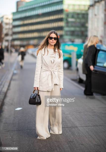 Sophia Roe is seen wearing belted jacket wide leg pants outside Blanche during the Copenhagen Fashion Week Autumn/Winter 2019 Day 1 on January 29...