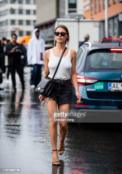 Sophia Roe is seen wearing black denim shirts white top heels outside Ganni during Copenhagen Fashion Week Spring/Summer 2020 on August 08 2019 in...