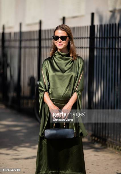 Sophia Roe is seen wearing green silk dress, black bag outside Dion Lee during New York Fashion Week September 2019 on September 11, 2019 in New York...