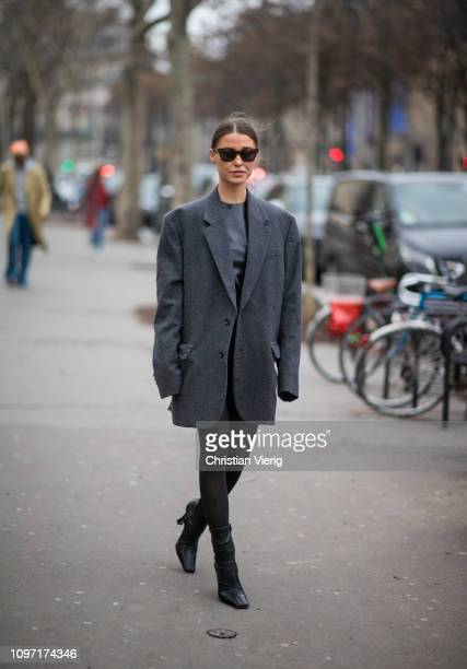 Sophia Roe is seen wearing grey oversized blazer sheer tights black boots outside Acne during Paris Fashion Week Menswear F/W 20192020 Day Six on...