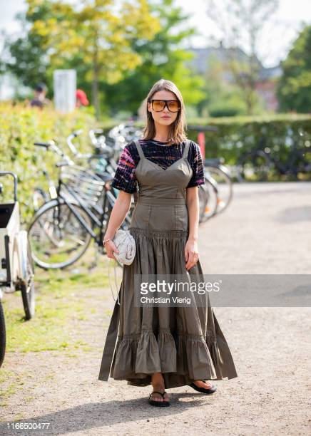 Sophia Roe is seen wearing olive dress outside MUF10 during Copenhagen Fashion Week Spring/Summer 2020 on August 06 2019 in Copenhagen Denmark