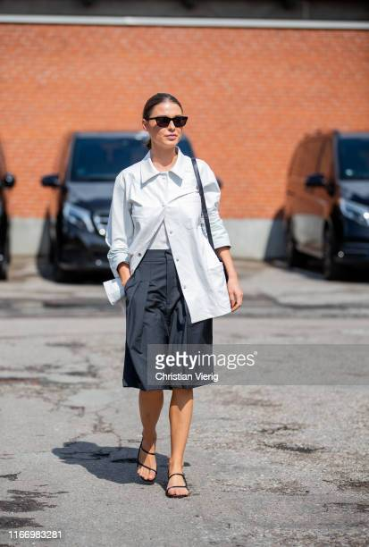 Sophia Roe is seen wearing white button shirt black shorts outside By Malene Birger during Copenhagen Fashion Week Spring/Summer 2020 on August 08...