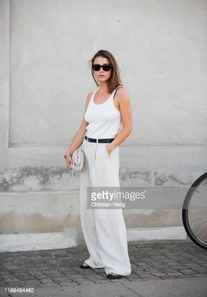Sophia Roe is seen wearing white wide leg pants outside Mykke Hofmann during Copenhagen Fashion Week Spring/Summer 2020 on August 06, 2019 in...