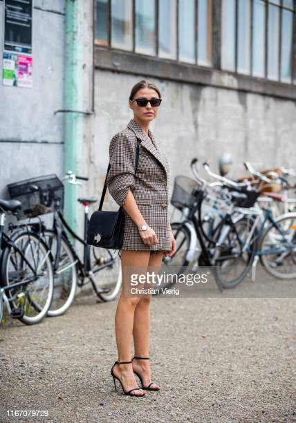 Sophia Roe seen wearing plaid brown blazer outside Baum und Pferdgarten during Copenhagen Fashion Week Spring/Summer 2020 on August 08, 2019 in...