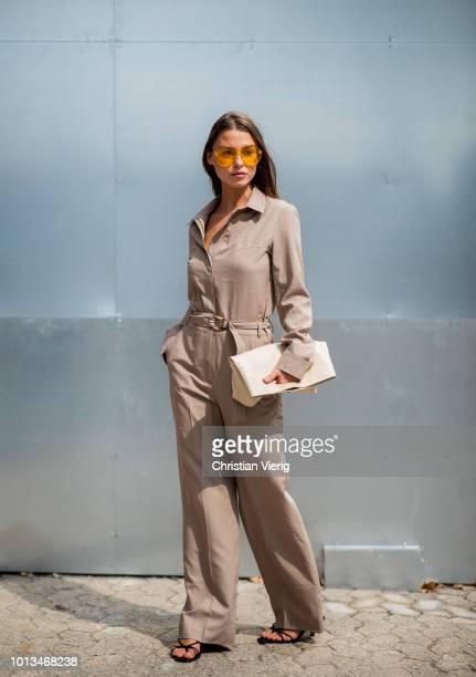 Sophia Roe wearing brown overall is seen outside Holzweiler during the Copenhagen Fashion Week Spring/Summer 2019 on August 8 2018 in Copenhagen...