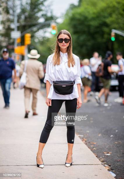 Sophia Roe wearing cropped leggings white button shirt fanny bag is seen outside Tory Burch during New York Fashion Week Spring/Summer 2019 on...