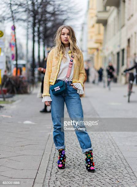 Sophia Scholl wearing a yellow jacket denim jeans mulit color boots Furla bag blouse with wide legs during the MercedesBenz Fashion Week Berlin A/W...