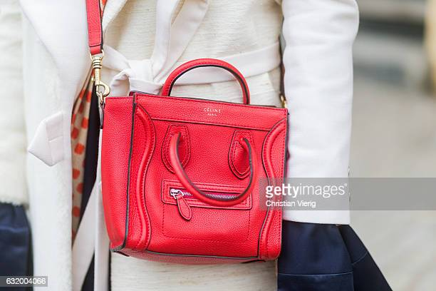 Sophia Schwan wearing a creme coat Bobby Kolade dress william fan red Celine bag Zara shoes Blazer Ef Berlin during the MercedesBenz Fashion Week...
