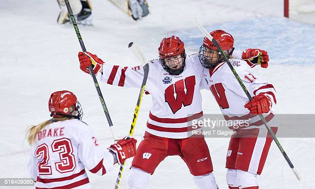 Sophia Shaver of the Wisconsin Badgers celebrates her goal against the Minnesota Golden Gophers with teammates Erika Sowchuk and Kim Drake during...
