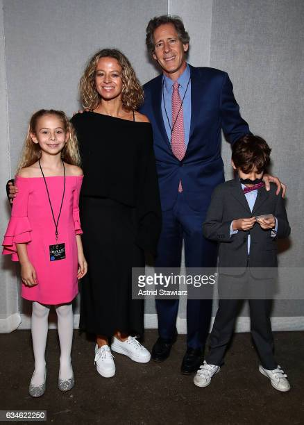 Sophia Smith, designer Michelle Smith, Andrew Oshrin and William Smith poses backstage of the Milly show during New York Fashion Week on February 10,...