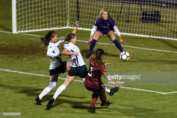 Sophia Smith of Stanford University has a shot on University of Arizona goalkeeper Lainey Burdett defended by Hallie Pearson at Laird Q Cagan Stadium...