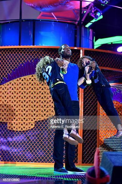 Sophia Strahan host Michael Strahan and Isabella Strahan onstage during Nickelodeon Kids' Choice Sports Awards 2014 at UCLA's Pauley Pavilion on July...