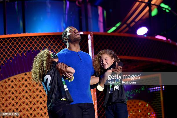 Sophia Strahan host Michael Strahan and Isabella Strahan speak onstage during Nickelodeon Kids' Choice Sports Awards 2014 at UCLA's Pauley Pavilion...