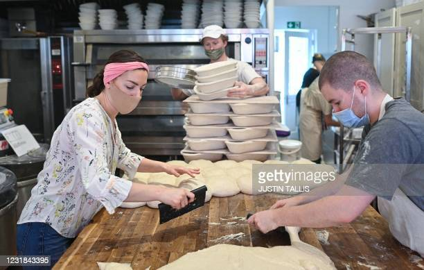 Sophia Sutton-Jones shapes the dough after bulk fermentation at Sourdough Sophia bakery in north London on March 18, 2021. - When Britain first...
