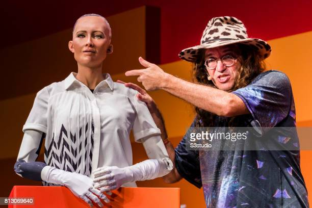 Sophia the Robot robot of Hanson Robotics and Ben Goertzel chief scientist of Hanson Robotics attend the Day 2 of the RISE Conference 2017 at the...