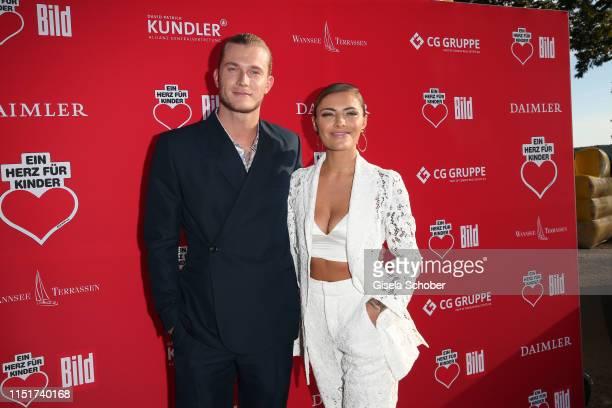 "Sophia Thomalla and her boyfriend Loris Karius during the ""Ein Herz fuer Kinder"" summer party on June 24, 2019 at Wannseeterrassen in Berlin, Germany."