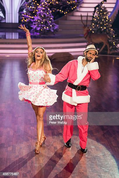 Sophia Thomalla and Massimo Sinato perform during the Final of 'Let's Dance Let's Christmas' TV Show on December 21 2013 in Cologne Germany