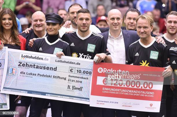 Sophia Thomalla Lukas Podolski and Markus Krampe attend the Schauinsland Reisen Cup 2018 at Schwalbe Arena on January 7 2018 in Gummersbach Germany