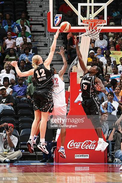 Sophia Young and Ann Wauters of the San Antonio Silver Stars challenge the shot by Stacey Lovelace of the Atlanta Dream during the WNBA game on June...