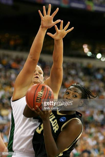 Sophia Young of the Baylor Lady Bears is defended by Kelli Roehrig of the Michigan State Spartans in the 2005 Women's NCAA Basketball National...
