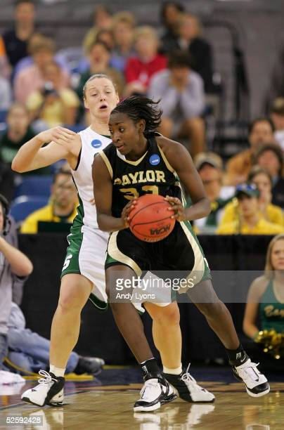 Sophia Young of the Baylor Lady Bears moves around Liz Shimek of the Michigan State Spartans in the 2005 Women's NCAA Basketball National...