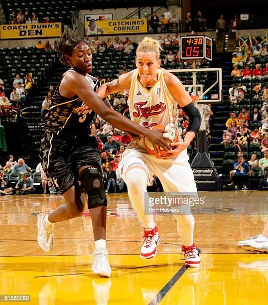 Sophia Young of the San Antonio Silver Stars defends Katie Douglas of the Indiana Fever at Conseco Fieldhouse on June 15 2008 in Indianapolis Indiana...