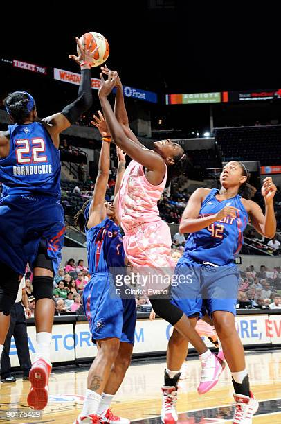 Sophia Young of the San Antonio Silver Stars fights for the ball against Alexis Hornbuckle of the Detroit Shock on August 29 2009 at the ATT Center...
