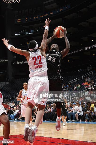 Sophia Young of the San Antonio Silver Stars goes to the basket under pressure against Betty Lennox of the Atlanta Dream during the WNBA game on June...