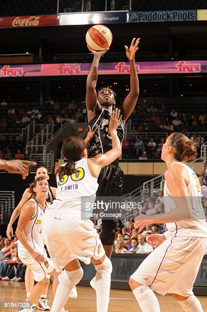 Sophia Young of the San Antonio Silver Stars shoots against Tangela Smith of the Phoenix Mercury on July 15 at US Airways Center in Phoenix Arizona...