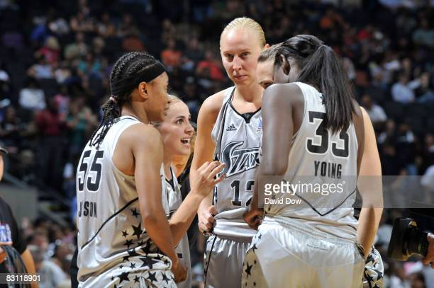 Sophia Young Vickie Johnson Becky Hammon Ann Wauters and Erin Buescher of the San Antonio Silver Stars prepares against the Detroit Shock during Game...