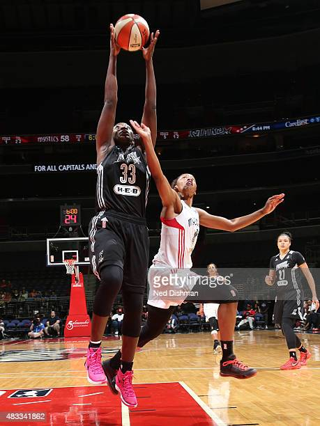 Sophia YoungMalcolm of the San Antonio Stars grabs the rebound against Tayler Hill of the Washington Mystics on August 5 2015 at the Verizon Center...