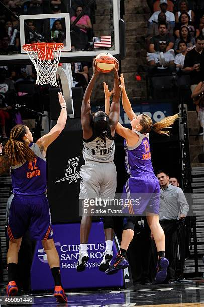 Sophia YoungMalcolm of the San Antonio Stars rebounds the ball against Brittney Griner and Penny Taylor of the Phoenix Mercury at the ATT Center on...