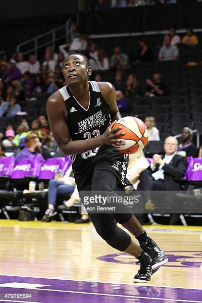 Sophia YoungMalcom of the San Antonio Stars handle the ball against the Los Angeles Sparks in a WNBA game at Staples Center on July 2 2015 in Los...